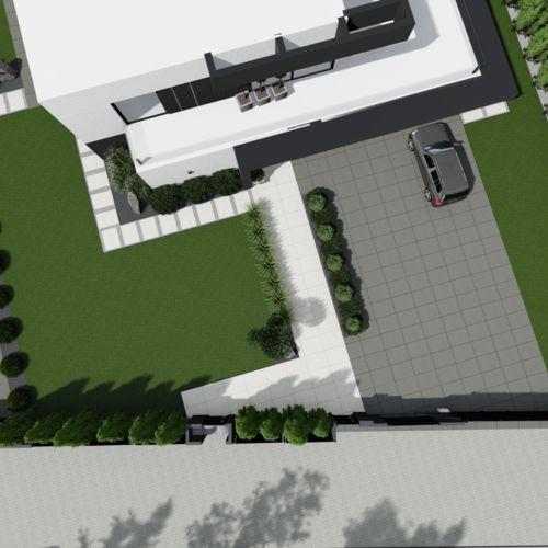 Ogród minimalistyczny przy nowoczesnym domu jednorodzinnym