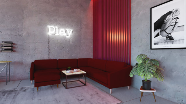 Widok na piękną czerwoną kanapę, z neonem który nadaje...