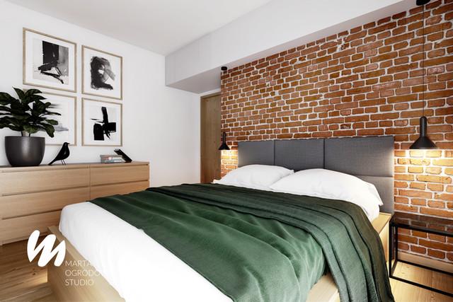Sypialnia z ceglaną ścianą z przylegającą garderobą