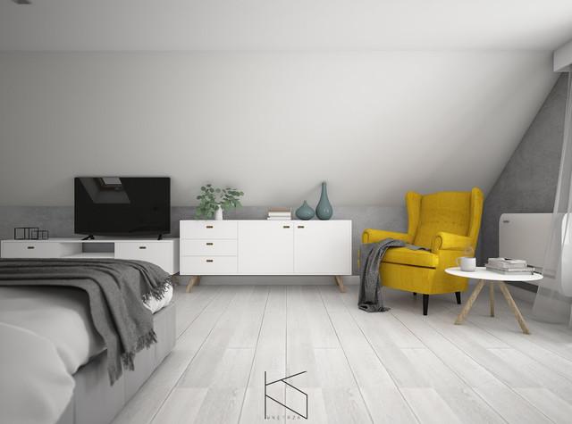 Długa i wąska sypialnia na poddaszu