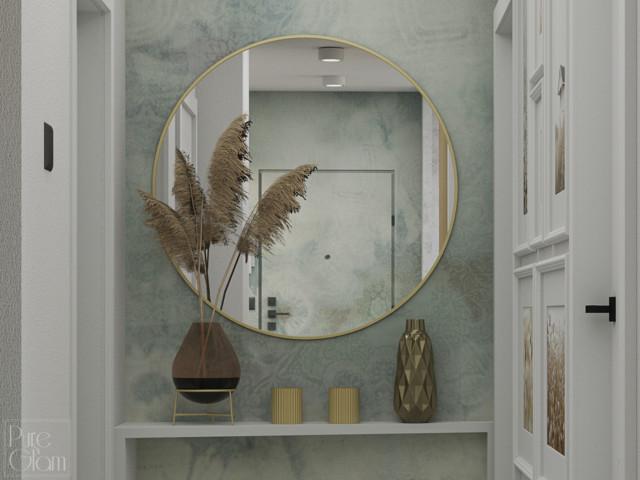 Hol rozświetla okrągłe lustro w złotej ramie, a także...