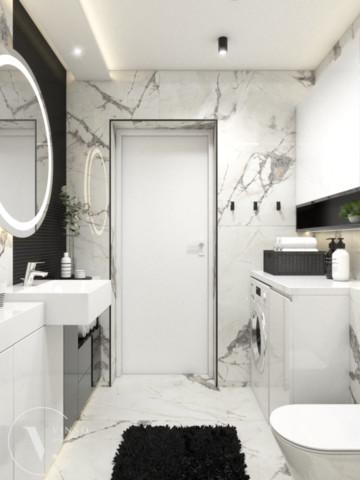 Elegancka łazienka w czarno-białej kolorystyce.
