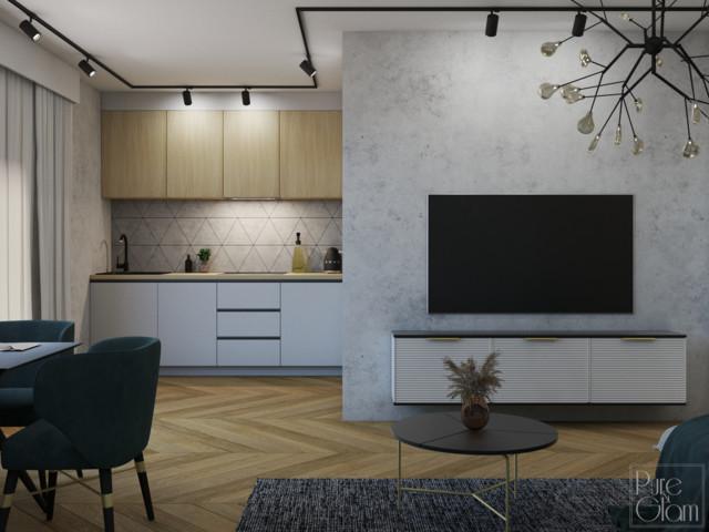 Ściana z telewizorem została wykończona betonem architektonicznym....