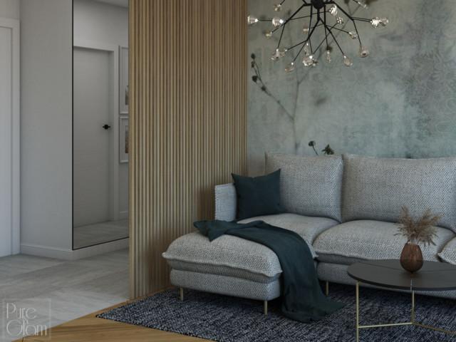 Salon został oddzielony od przedpokoju ścianą z drewnianych...